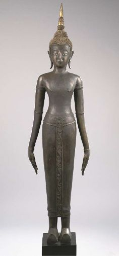 A Laos bronze figure of Buddha Sakyamuni 18th century Standing in samabhanga, both hands stretched along the body, wearing diaphanous samghati and shoes, his face with serene expression, mother-of-pearl inlaid eyes, elongated earlobes, curled hairdress and usnisha surmounted by a separate cast flame, traces of gilding 160 cm. high, mounted Gautama Buddha, Buddha Buddhism, Buddhist Art, Laos, Thailand History, Buddha's Hand, Asian Sculptures, Buddha Statues, Asian Art
