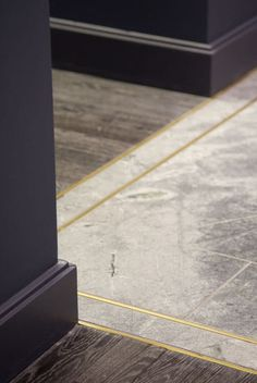 """God,"" German architect Mies van der Rohe once famously said, ""is in the details."" It's hard to imagine more beautiful details than these eight boundaries where two flooring surfaces meet, marrying different materials in innovative and elegant ways. If you decide to imitate these transitions in your own home, don't be surprised if everyone spends all their time looking down."