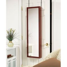 @Overstock - Make sure you look good from head to toe with this classic large wall mirror. The shatterproof mirror features a beautiful cherry-wood frame and can be hung on a wall or door.http://www.overstock.com/Home-Garden/Cherry-Wood-Hanging-Armoire-Mirror/6461273/product.html?CID=214117 $114.99
