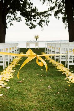 I like the idea of tying off the center aisle so that no one walks down it before the bridal party