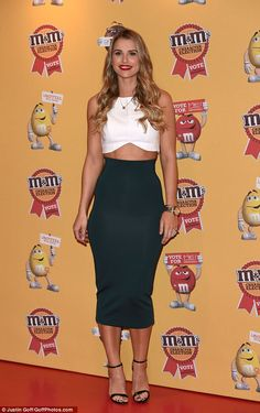 Fashion by name... Vogue Williams arrived looking glamorous in a white crop top and a figu...