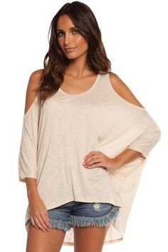 High Low Peek A Boo Top Wear this great top with so many different things!  This is a great top to have in your closet!