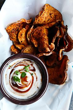 Oven-Baked Honey Barbecue Sweet Potato Chips; 1 medium sweet potato,   2 Tbsp. Olive oil, 1 Tbsp honey or agave nectar, 1/2 tsp chili powder,   1/2 tsp paprika    1/2 tsp onion powder    1/4 tsp sea salt
