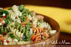 Perfect Pasta Salad  •Tricolor Rotini Pasta  •1 onion-chopped  •1 red pepper-chopped  •1 green pepper-chopped  •Mozzarella cheese •1 bottle Italian Dressing  •1 tsp Italian Seasoning  •Salt & Pepper to taste