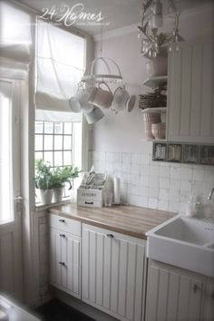 Love the small hanging rack, its perfect for this corner and the small-paned window is wonderful (Vintage Top Shabby Chic) Cottage Kitchens, House Inspiration, House Styles, Interior, Chic Kitchen, Home Decor, House Interior, Shabby Chic Kitchen, Shabby Chic Homes