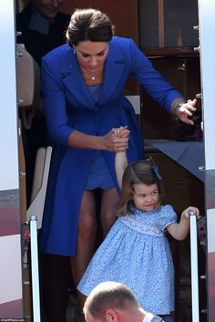 Princess Charlotte carefully disembarks the private plane, with a helping hand from her mother in Germany. July 2017. Kate, child, daughter, blue coat and dress