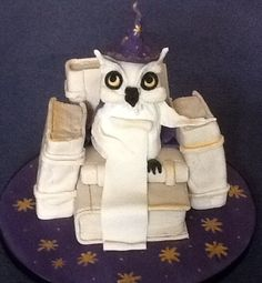 Wizard owl sitting on the Chair of Wisdom made by wizard cakes