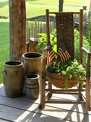 Olde Crocks...and a rocker with a plant.