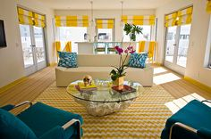 Chevron rug! Love the coffee table and the gold skull!