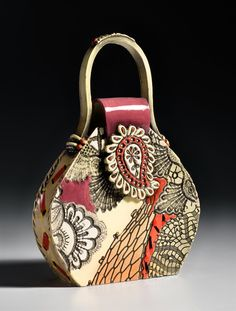 This hand built ceramic piece uses a unique process where I press antique and contemporary textures into clay. The surface is hand painted with...
