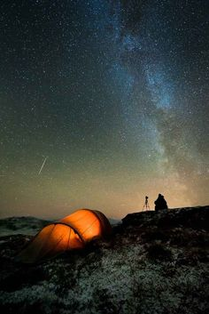 An astrophotographer watching a meteor streak across the sky. | 15 Photos Of The Night Sky That Will Fill You With Awe