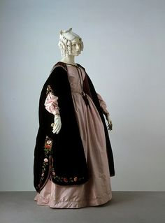 Dress    Place of origin:  England, Great Britain (made)    Date:  1838-1842 (made)    Artist/Maker:  unknown (production)    Materials and Techniques:  Silk, trimmed with silk braid, lined with cotton, hand-sewn