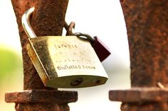 Rusty padlock on a bridge in Verona with Romeo and Giulietta names engraved
