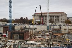 The rail car being held by two cranes.  #nmaahc #construction
