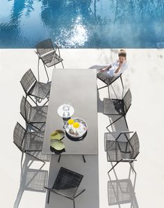 Outdoor furniture by Tribù. Branch collection in dark wengé colour. The frame of the chair is made of aluminium. The seat and backs are polypropylene.