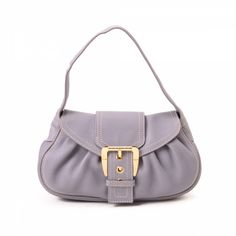 cb179a2ed230 LXRandCo guarantees the authenticity of this vintage Céline Buckle handbag.