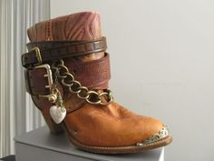 Belted cowboy boots with added baubles/trinkets!