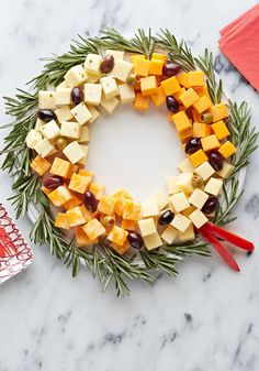 Easy Cheese Wreath — Arrange a variety of delicious, creamy cheese cubes in a circle, add olives, and you've got yourself a simple and elegant appetizer recipe.