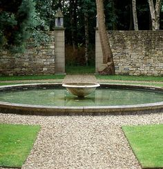 ANOUSKA HEMPEL- England Wiltshire Garden like the stone fence - we could do this and use the formula to make young walls look aged in Tara Dillards book (buttermilk. Side Yard Landscaping, Modern Landscaping, Water Features In The Garden, Garden Features, Water Garden, Lawn And Garden, Garden Pond, Contemporary Garden Design, Landscape Design
