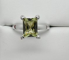 We are so pleased to offer this Natural Zultanite® & Diamond ring set in 14k solid gold. This beautiful ring features an 9x7mm octagon cut Zultanite gemstone that weighs 2.35 carats. The gem is set in a raised four prong style setting with a natural Diamond accent set within each of the prongs. This piece would make such a great engagement ring! The combined weight of the four Diamonds is .12 carats. The setting is 14k solid gold. The band measures 2.85mm at the shoulders and tapers down...