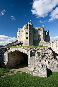Warkworth Castle is a ruined medieval building in the town of the same name in the English county of Northumberland. The town and castle occupy a loop of the River Coquet, less than a mile from England's north-east coast.