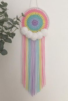 Pastel Rainbow Crochet Dreamcatcher with Pom Poms Crochet Home, Free Crochet, Knit Crochet, Crochet Dreamcatcher Pattern, Dream Catcher Craft, Crochet Wall Hangings, Rainbow Crochet, Yarn Crafts, Crochet Projects