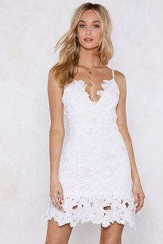 Take it easy, babes. The Lace Yourself Dress comes in crochet lace and features a mini, fitted silhouette, V-neckline, adjustable straps, and zip closure at back. Partially lined.