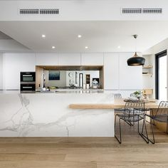@westerncabinets utilized polytec's Crisp White Legato in conjunction with natural timber and marble in this project, a beautiful contrast of textures and colours. #polytec #westerncabinets #legato #homeinspo #kitchen