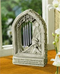 "The precious memories windchime is a beautiful sympathy gift option.   Chime reads, ""May the sweet song created by each gentle breeze provide you  with comfort and precious memories."""