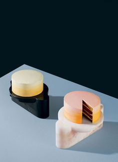 Cake stand by Egg Collective and Marsotto. Executed in solid marble by Marsotto, Egg Collective's curvilinear cake stand features an elongated base topped with a round tray that can be lifted off or easily locked into place. The polished surface adds a luxurious dimension.