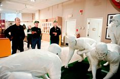 10-23-14 - N.F.L. Teams Harness Stadiums as Museums - NYTimes.com - Shown, Statues depicting the 1967 Ice Bowl game, Packers Hall of Fame, Green Bay, WI.
