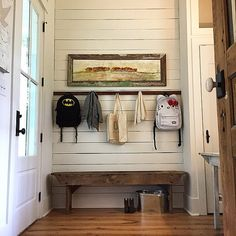 No mudroom, no problem!  Add a cute bench, some way to hang a coat or bookbag, some pretty shiplap and artwork AND voila!!!!!  Mudroom!