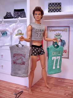 "Ken doll with personalized custom doll clothes Aside from the no pants and it's a ken doll he's wearing a shirt that says ""GUAM"" how cool is that."