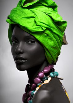 Black & Beautiful! Love the contrast of her skin with the jewelry! And the pretty green turban/gele?