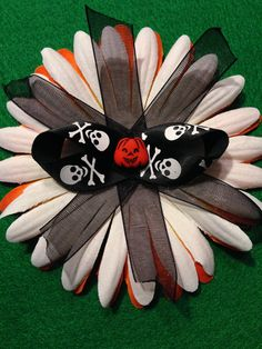 Flower Dog Collar  I.M. Spooky Collection - This bones and pumpkin dog flower collar bow is ready to belong to a good pooch.  With a soft felt back and a Velcro tie this pet bow is comfortable and stylish.   Buy this bow for your pet and help another pet at the same time.    Visit our Facebook page at: https://www.facebook.com/pages/Isabellas-Pet-Shop/525414240872090 Thank you and all the best!
