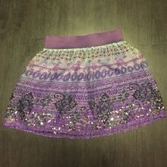 Beaded Bohemian Skirt Beautiful beaded, bohemian skirt. Gently worn once. Beading is in wonderful condition. Charlotte Russe Skirts Mini