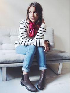 Lizzy vd Ligt wears a striped sweater, cuffed jeans, a neckscarf, and chelsea boots