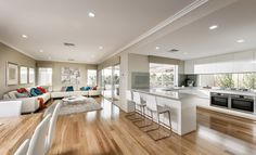 http://www.newhomesguide.com.au/builders/ben-trager-homes/homes/double-storey/the-kolber  Absolutly love the window splashback, great for natual light and watching kids