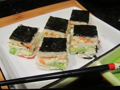 """SIMPLE STACKED SUSHI ~ I've tried the roll-your-own sushi and it works–sometimes. A couple years ago, I came across a recipe for stacked sushi in a cookbook titled """"Bite Me"""" and had to try it. And modify it. It's now a family favorite–easy to make and less expensive than restaurant- or store-bought sushi. Our family prefers sushi with pre-cooked shrimp or imitation crab, but if you're more adventurous, you can substitute raw fish."""
