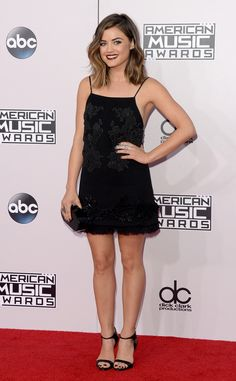 Lucy Hale looks adorable in this slip dress on the 2014 AMAs red carpet!