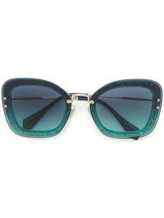13d16d179c26 Shop now Miu Miu Eyewear oversized sunglasses for at Farfetch UK.