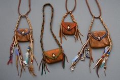 Patterns and tips for constructing small leather pouches/amulet bags. I love the idea of sewing buckles onto the sides to thread straps and fringe through.