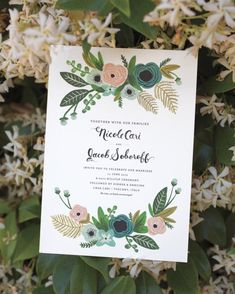"A vintage-inspired floral motif and whimsical calligraphy animated the invites by Rifle Paper Co. ""I wanted them to be as romantic as Italy,"" says Nicole, who wed in Tuscany."
