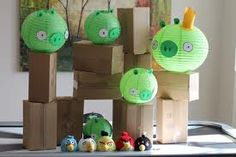 Activity for an Angry Birds Birthday Theme- Empty cardboard boxes, green paper lanterns decorated into 'pigs'!