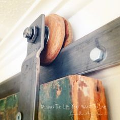 Sliding barn door tutorial. Wooden wheels with ball bearings in center available for $60 for two.