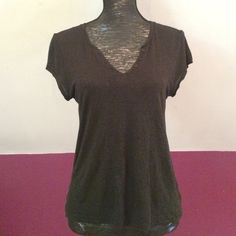 Free People Itty Bitty Tee Basic black tee from FPs We The Free label. The neckline has a v shape with 3 buttons. In gently worn condition. 70% rayon, 30% linen. Free People Tops Tees - Short Sleeve