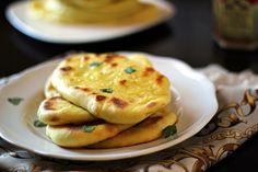 Indian Naan Bread_Ingredients •3 to 4 c. all-purpose flour •1 tsp. salt •½ tsp. instant yeast •1¼ c. milk •¼ c. plain Greek yogurt •1 tsp. sugar •⅛ tsp. ground cardamom •⅛ tsp. ground turmeric •4 Tbsp. melted Ghee or butter