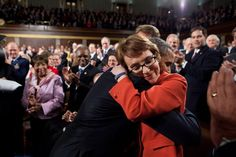 """timelightbox: Pete Souza/The White House """"President Barack Obama greets then Rep. Gabrielle Giffords, D-Ariz., as he arrives to deliver the State of the Union address in the House Chamber at the U. Capitol in Washington, D. Obama Photographer, Obama Photos, Obama Images, State Of The Union, We Are The World, Michelle Obama, Barack Obama, The Life, Henna"""