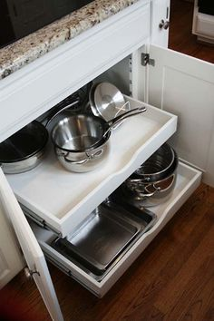 Kitchen Renovation with Giallo Ornamental Granite Countertops, Pull-out Shelves and White Painted Cabinets