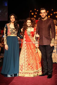 Bhumika wears a teal blue gown with a Fuschia pink yoke with velvet applique and bold zardozi embroidery